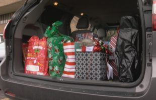 NYSEG employees deliver gifts to families in need